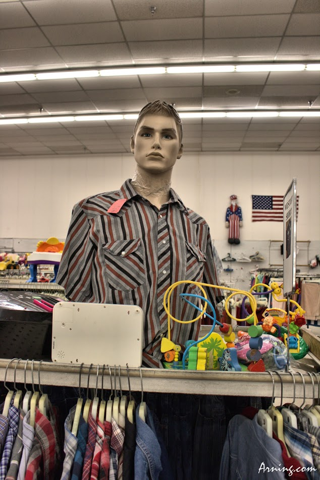 Mannequin with his head taped on at the Family Thrift Center